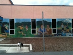 Darla and a One Voice mural on the Soledad YMCA.